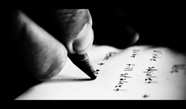 hand writing in pencil on paper