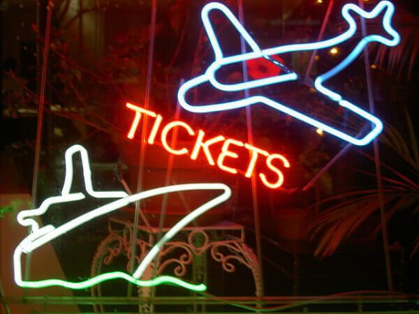 neon sign plane boat travel