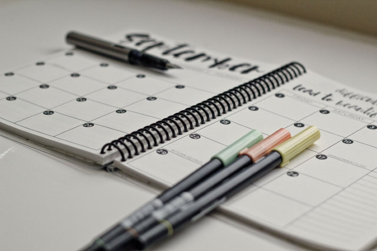 a planner calendar with pens ready to plan