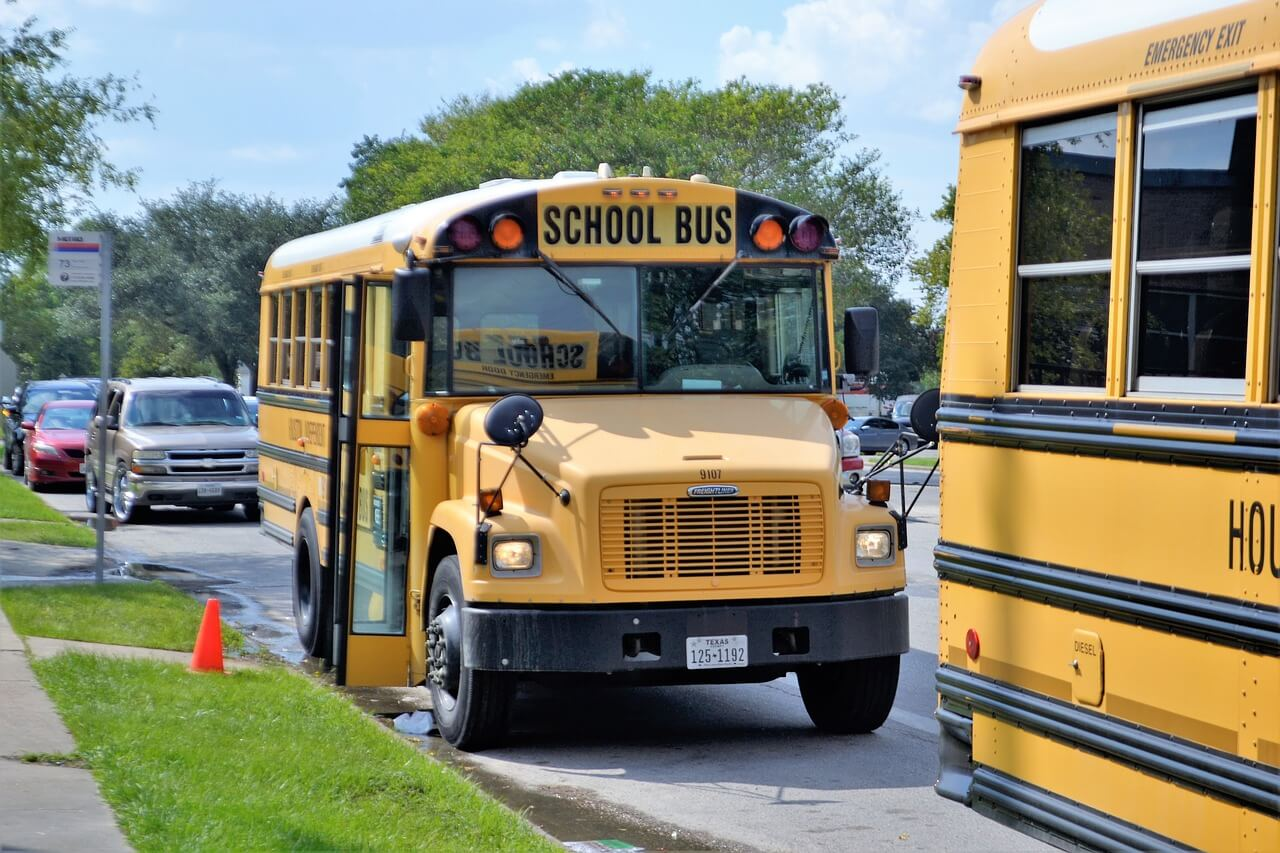 two school busses in an after school pick up lane